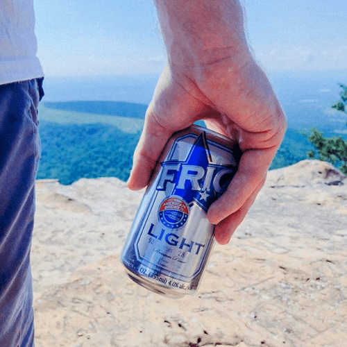 Low Calorie Light Enjoy FRIO Can held in hand